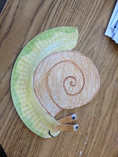 Snail and Turtle Are Friends - paper plate art of a snail. Could be used for display or retelling activities in the classroom.