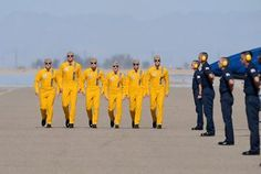 """The Blue Angels jet pilots -- wearing """"throwback"""" gold flight suits -- commence their pre-flight walkdown at the first Blue Angel flight demonstration of the 2014 air show season at NAF El Centro, Calif. Military Jets, Military Aircraft, Military Soldier, Us Navy Blue Angels, Pilot Uniform, Angel Flight, F4 Phantom, Female Pilot, Air Show"""