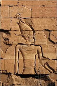Picture of Carving of the Ancient Egyptian God Amun, wearing the horns of the goat god Khnum.  Wall of the Temple of Kalabsha on Lake Nasser, near Aswan, Egypt.