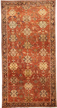 A late 19th century Persian Sultanabad antique rug, the abrashed soft red field with an allover pattern of bold polychrome cartouches, delicate flowering vine, and whimsical leaves issuing from polychrome rosettes, within a midnight blue field of condensed scrolling vines and flowerheads.  Watch full size video of A Persian Sultanabad rug, Circa 1880, ID BB4360 - Video