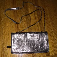 Tory Burch Cross Body Like new condition. Fold over style with zippered portion on one side and card slots on the other. Buttons closed. Pewter in color. Tory Burch Bags Crossbody Bags