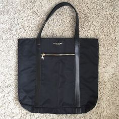 Givenchy bag Givenchy bag. No pockets. No zipper for main opening. Great for carry on bag or beach! Givenchy Bags Shoulder Bags
