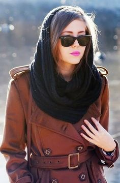 Snood/cowl, sunglasses, trench.
