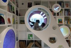 This space was an inspiration to me in a children's store I designed.  I love that the kids can interact with the space an in turn the product.  Has a very inviting and hands on feel to the design.