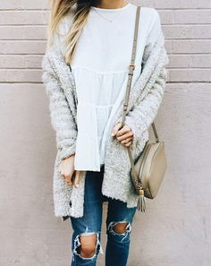 Loose tunic top with distressed denim, loafers and topped with an oversized boyfriend cardigan