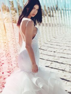 "Introducing ""Lucite"" by Lauren Elaine Bridal. Part of the ""Prismatic Planet"" sequin bridal collection by celebrity Designer Lauren Elaine, ""Lucite"" shines with a decadent art-deco patterned backless mermaid silhouette and billowing feathered tulle skirt with scalloped horsehair petals and cathedral train. Book an appointment at our Los Angeles Flagship or one of our exclusive salon retailers or trunk shows to view and fit this beauty today! #LaurenElaineBridal"