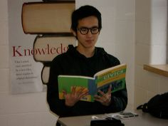 Eison reading Civics in class at SFDCI. Lunch Box, Reading, Bento Box, Reading Books