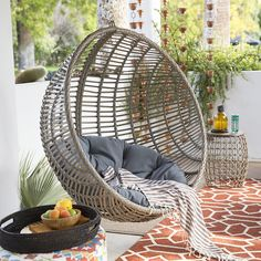 Resin wicker hanging chair: http://www.stylemepretty.com/living/2016/05/26/10-hammocks-to-lounge-in-all-summer-long-cocktail-in-hand/