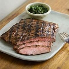 Light brown sugar and honey are blended with soy sauce, garlic, and green onion to make a savory sweet marinade for flank steak.
