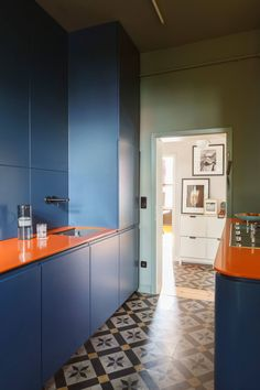 A cement tile floor set the color scheme for the rest of a Frankfurt, Germany kitchen by Studio Oink. The walls are Farrow & Ball Card Room Green and the custom cabinets are Stiffkey Blue. Photograph courtesy of Studio Oink. Apartment Interior Design, Kitchen Interior, Interior Decorating, Small Basement Kitchen, Kitchen On A Budget, Modern Basement, Commercial Interior Design, Commercial Interiors, Style At Home