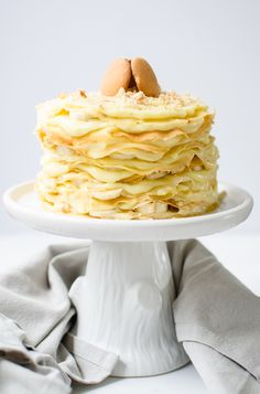 This 12 Layer Banana Pudding Crepe cake has buttery crepes piled high with a creamy vanilla pudding, sliced bananas, & crumbled Nilla wafer cookies!