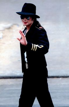 Michael Jackson waves goodbye just before attempting to walk across the ocean