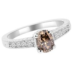 Jewelry Point - 1.03ct Oval Champagne Brown Diamond Engagement Ring, $1,790.00 (http://www.jewelrypoint.com/1-03ct-oval-champagne-brown-diamond-engagement-ring/)