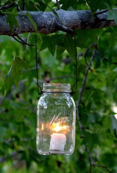 Magical DIY Hanging Mason Jar Lights (Easiest Ever!) The easiest & super charming DIY hanging mason jar lights using up-cycled glass bottles and dry cleaners wire hangers. Detailed step by step tutorial! - A Piece of Rainbow