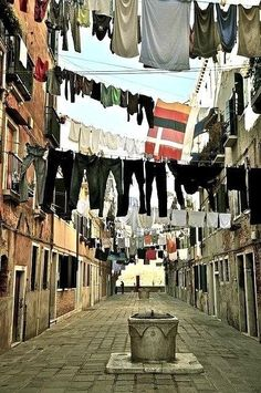 A prettied-up version of a typical scene - laundry hanging between buildings!  Naples Italy