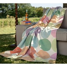 Keep yourself warm with the cozy Pure Candy throw constructed of 100-percent cotton. Featuring colorful dots, this blanket wicks away moisture and conserves body heat to keep you comfortable regardless of the season.