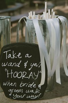 Cute celebration wands. Really cute idea. Sweet keepsake and a great way for the guests to celebrate when the newly weds walk in.: