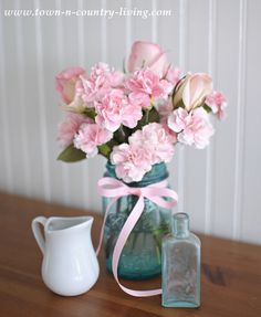 Spring decorating with pink flowers in a blue mason jar
