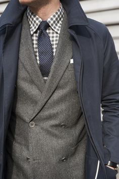 Grey double-breasted jacket with grey plaid shirt and navy stripe tie
