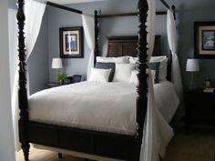 Dark, tropical wood tones and airy white sheers evoke your own private island retreat.