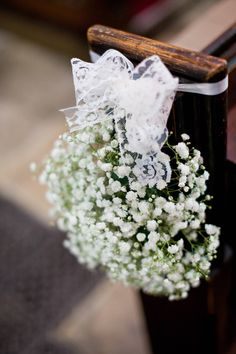 gypsophila baby's breath bundles tied with lace at the ends of the pews in the church to line the aisle - Natasha Cadman Photography - Bride in Lace Pronovias Gown & Jimmy Choo Shoes for an elegant classic wedding in York with lilac Coast bridesmaids dresses, gypsophila posies, Navy Groomsmen suits & fish & chip supper.