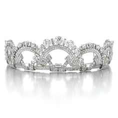 FINE AND ELEGANT DIAMOND TIARA, MONTURE BOUCHERON, 1937. Designed as a series of interlocking geometric arches, set with circular-, single-cut and baguette diamonds, mounted in platinum, inner circumference approximately 300mm, signed Monture Boucheron, French assay and maker's marks, three small diamonds deficient, fitted case Boucheron, Paris. 26 Place Vendôme.