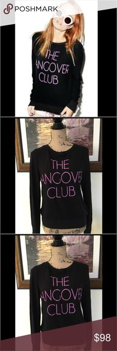 "🎉HP🎉Wildfox ""Then Hangover Club"" Black Sweater Wildfox ""The Hangover Club"" Black Sweater.  Brand new with tags.  Adorable, super soft and comfortable sweater to wear all season long. Black with pink letters.  Sold out in stores. Wildfox Sweaters Crew & Scoop Necks"