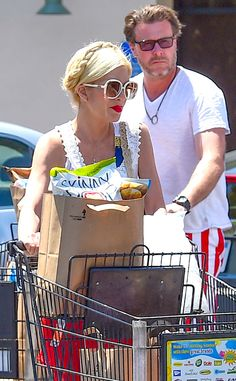 The fabulous Tori Spelling got into the July 4th spirit by rockin' white oversized square butterfly sunnies and a vibrant red lip!
