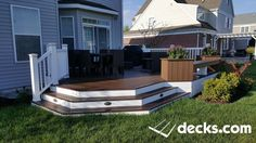 This is a deck that features bay stairs, Azek skirting, and low voltage post light modules. All decking is Trex Transcend (Spiced Rum) with TimberTech Radiance Rails (White). Backyard Images Chicago IL