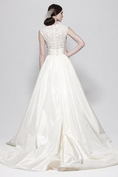 This would be beautiful with big full sheer sleeves gathered into cuffs.