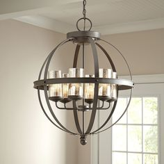 Tuscany Chandelier | A contemporary design with rustic Italian influence, this gorgeous 4-light style features spherical banding, delicate mercury glass, and a breathtaking bronzed finish.