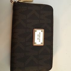 Michael Kors wallet This wallet is perfect and simple! Small enough to fit in a clutch but yet holds a good amount of cards Michael Kors Bags Wallets