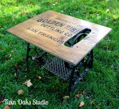 Industrial inspired coffee table using reclaimed wood and treadle sewing machine base