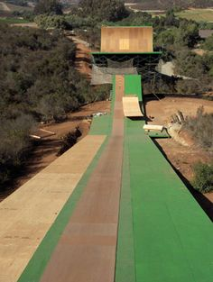 Largest skateboard ramp in the world located in Oceanside, California. It has a 180 foot long roll-in to a ramp that launches the skateboarder across a 70 foot gap with trapeze netting below. Skaters reach speeds up to 55MPH.