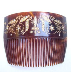 Late Victorian faux tortoiseshell back comb with gold inlay and clear rhinestone trim