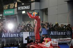 F1 Malaysia GP - Fernando Alonso celebrates his first victory of the season on top of his car