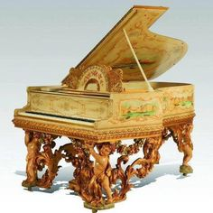 Astounding piano with putti and grape vine carvings.