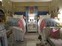 Entirely too fabulous for a real dorm room - Really really well done. Look at the bed skirts and the headboards -wow!