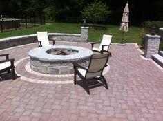 Granite fireplace on paver patio.