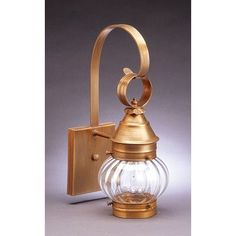 Northeast Lantern Onion 1 Light Outdoor Wall Lantern Finish: Raw Brass, Shade Type: Clear Seedy
