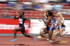 Myriam Soumare (L) from France and Ezinne Okparaebo (C) from Norway compete in the women's 100m heat during the European Athletics Championships 2014 in the Letzigrund Stadium in Zurich, Switzerland, August 12, 2014.