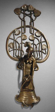 GUSTAV GURSCHNER (1873-1970) DOOR KNOCKER, CIRCA 1893 patinated brass 18½ in. (47 cm.) high stamped GURSCHNER MDCCCXCIII