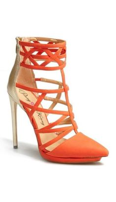 Gorgeous heels for the holidays. Coral orange cage high heel shoes
