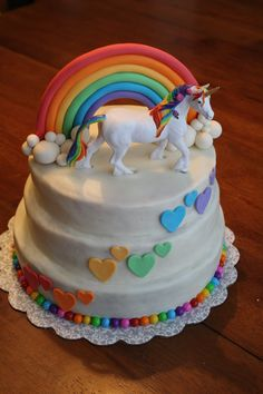 Unicorn Rainbow Cake - buttercream icing, fondant rainbow & hearts, sixlets around bottom, the unicorn is a figure I bought and painted - Rainbow Unicorn Party!