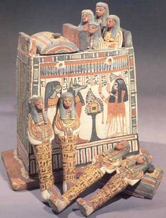 "Painted shanti box of the Theban priestess Henutmehyt. The painting shows her adoring two of the canonic deities. These shabtis are intended to carry out agricultural activities for her in the afterlife. The box was constructed of wood during Dynasties 19-20. It stands 13-1/2"" high"