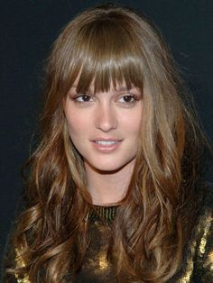Leighton Meester's jagged, brow-grazing bangs and smooth roots add contrast to her wavy hairstyle.