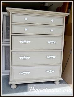 Old Dresser Refurbished, distressed with primer, gold metallic and Matha Stewrt's Bedford grey on top.  Don't care for knobs