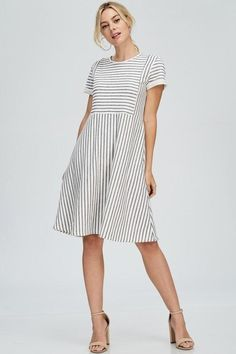 Casual Round Neck Midi Dress - Quality French Terry Fabric Hidden Hip Pockets Short Sleeve with Cuff detail Stripe Pattern Model is 5'9 and wearing a Small Care instructions - hand wash cold, do not bleach, hang or line dry - 47% Poly 38% Cotton 15% Rayon