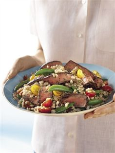 After marinating, steak can be grilled or broiled to perfection before being added to this fresh salad.