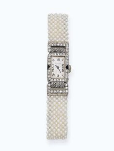 AN ART DECO PEARL AND DIAMOND WRISTWATCH, BY CARTIER   The rectangular-shaped silvered dial with Roman numerals within a diamond and onyx surround to the seed pearl bracelet with deployant clasp, circa 1925, dial 1.5 cm long, with French assay marks for platinum and gold, with red leather Cartier case  Signed Cartier, nos. 15596 and 25002, case signed European Watch and Clock Co Inc France, no. 15596, movement signed European Watch and Clock Co Inc